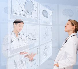 Women doctors using futuristic interfaces