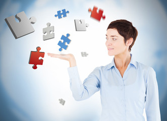 Cheerful woman with puzzles levitating