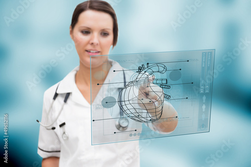 Nurses looking at a clipboard