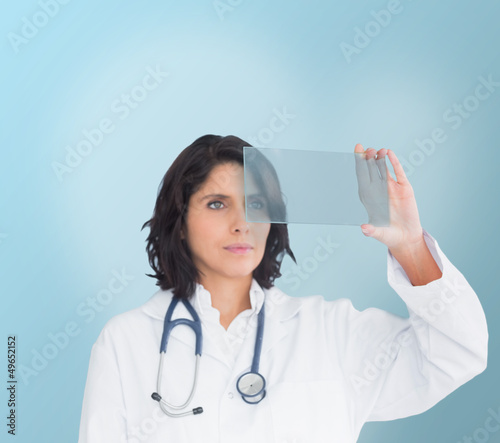 Brunette doctor looking at a screen
