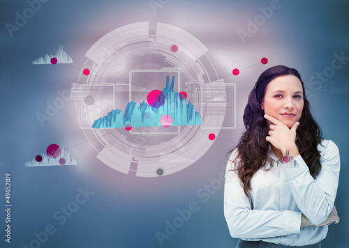 Businesswoman against a futuristic graph hologram
