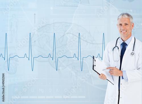 Portrait of senior cardiologist using a clipboard