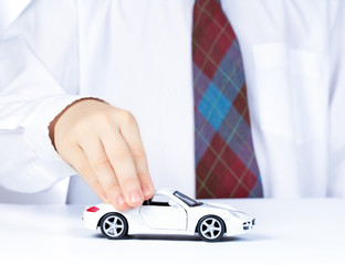 boy's hand with white toy car