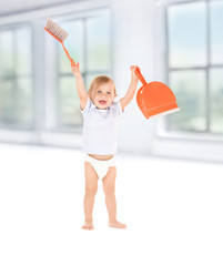 baby boy with with dustpan and brush