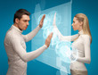 man and woman working with virtual screens