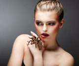 Beautiful Girl Holding Live Tamed Spider in her Hand