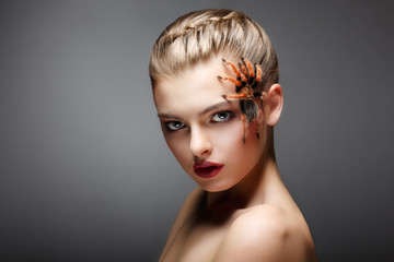 Spider-Girl Fashion Model with Poisonous Spider on her Face