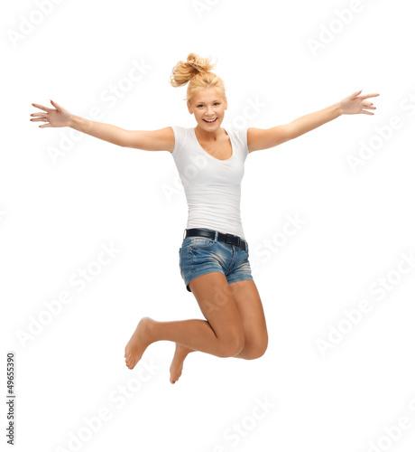 jumping teenage girl in blank white t-shirt