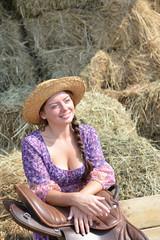 Girl resting near a haystack