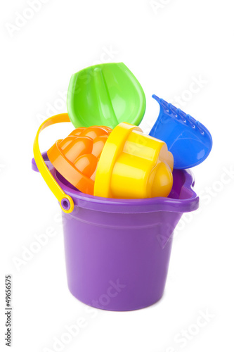 toy purple bucket with spade and rake