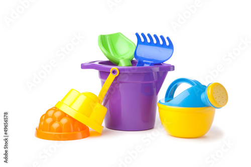 toy purple bucket with spade and rake, watering-can