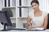 Hispanic Latina Woman or Businesswoman in Office