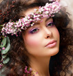 Pretty Woman with Wreath of Pink Flowers. Natural Beauty