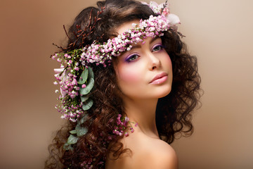 Nymph. Sensual Brunette with Garland of Flowers looks like Angel