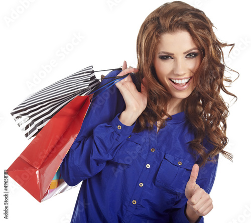 woman standing with shopping paper bags and showing OK by hand.