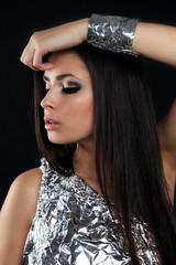 Sensual girl dressed with aluminum foil