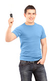 Young smiling guy holding car key