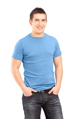 Smiling young man posing with hands in pockets