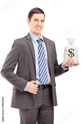 Happy young businessman holding a bag with US dollar sign