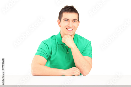 Young smiling man sitting