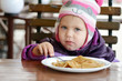 toddler girl eating pancakes