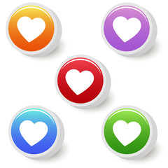 Five colorful buttons with heart
