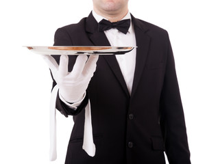 Cropped image of a young waiter holding an empty dish on white b