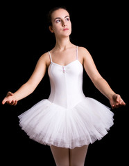 Ballerina posing against black background