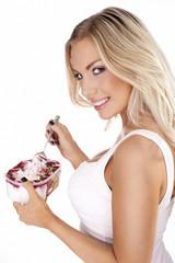 Beautiful blonde enjoying a delicious dessert