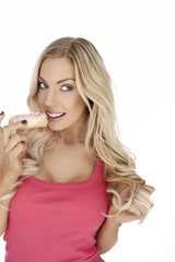 Glamorous blonde eating a cookie