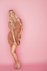 Beautiful blonde woman on pink