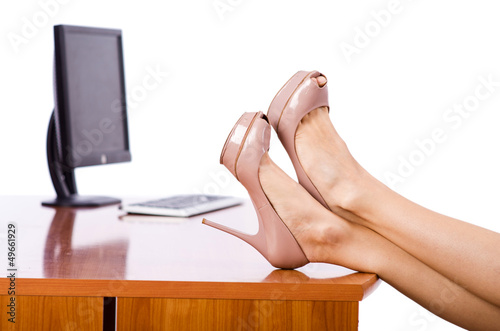 Woman legs on the desk