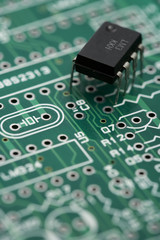 Microchip on green circuit board, close up
