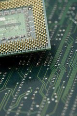 Computer CPU on green circuit board, close up