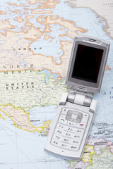 Mobile phone on a world map