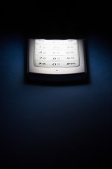 Illuminated cell phone keypad, close up
