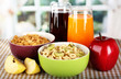 Delicious and healthy cereal in bowls with juice and fruit