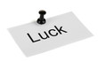 Push pin on paper with word luck written on it isolated on
