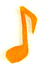 Decorative musical notes from dry orange peel isolated on white