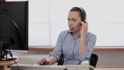 Woman with headphones listening to screaming customer