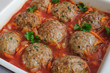 Meatballs with herbs and tomato sauce in the pan