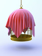 Birdcage suspended with red drape