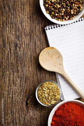 blank notebook and spices