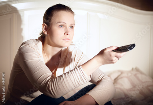 Young woman is watching tv.