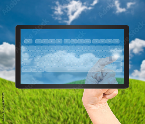 Hand pressing digital button on the black tablet.