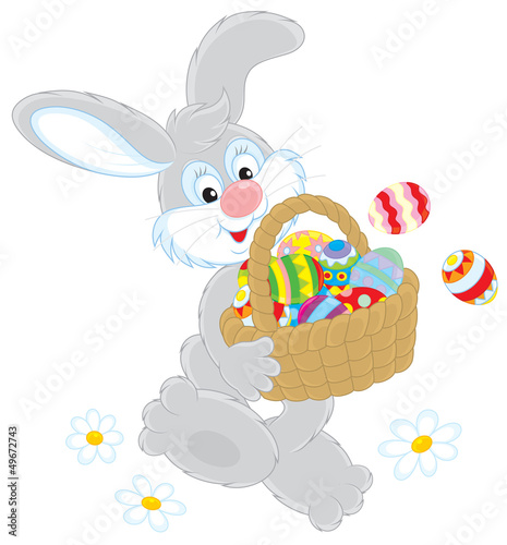 Easter Bunny with a basket of colorful painted eggs