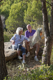 active senior couple looking for their way on a map
