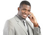 Smiling African American businessman on smartphone