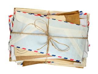 Pile of old envelopes isolated on white background