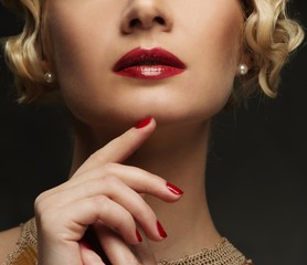 Close-up shot of beautiful woman face with red lips